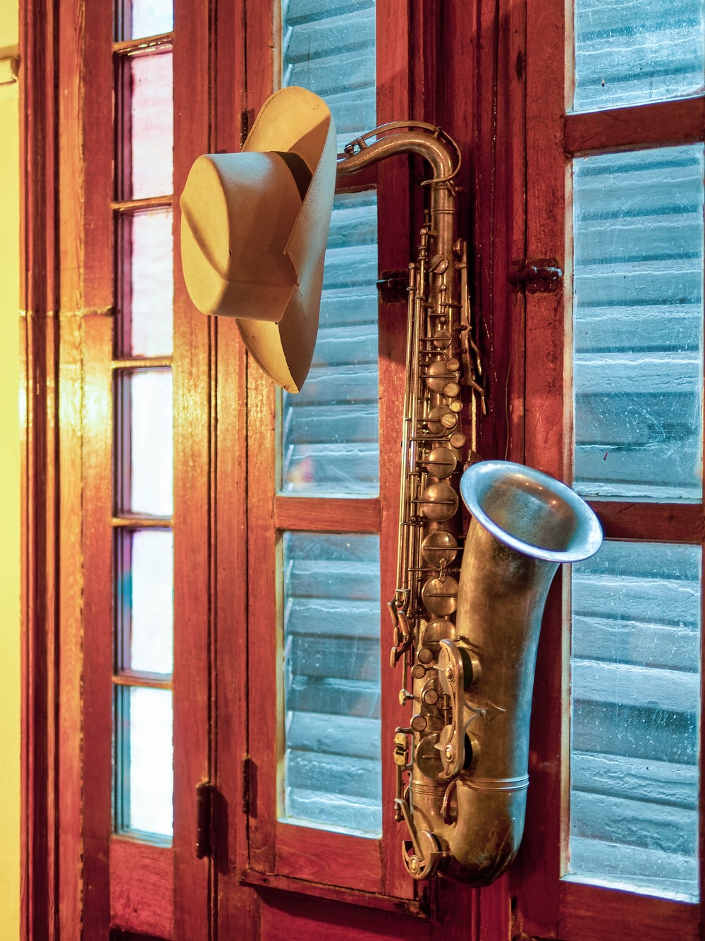 brown tenor saxophone mounted on wall