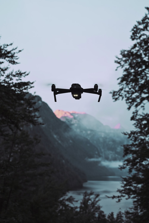 black drone under gray sky