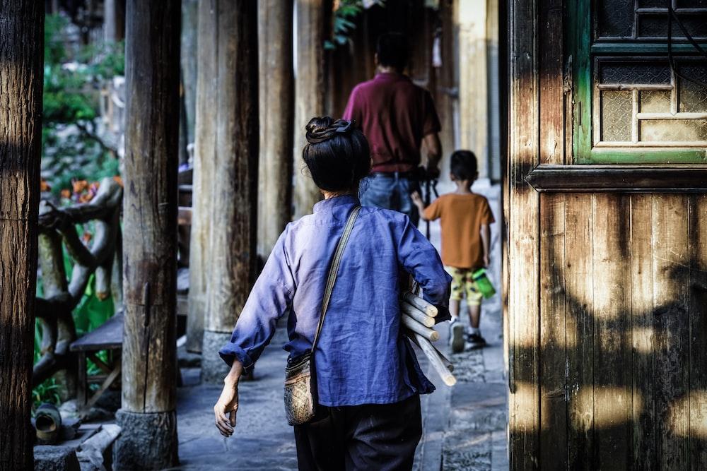 child walking near wooden building