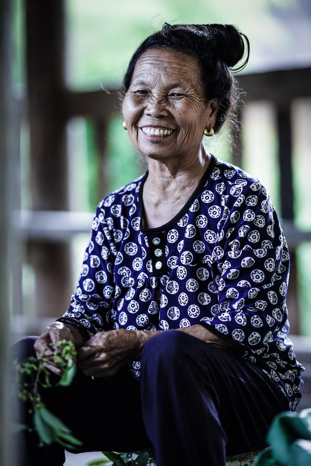 woman sitting near handrail