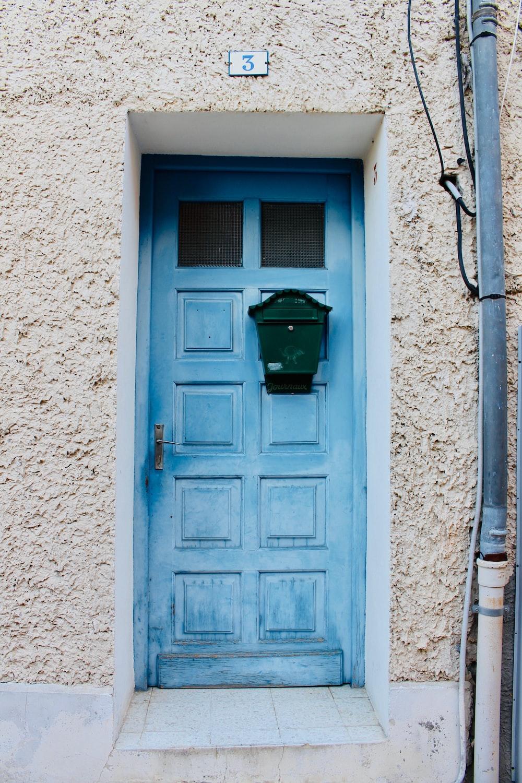 teal wooden door
