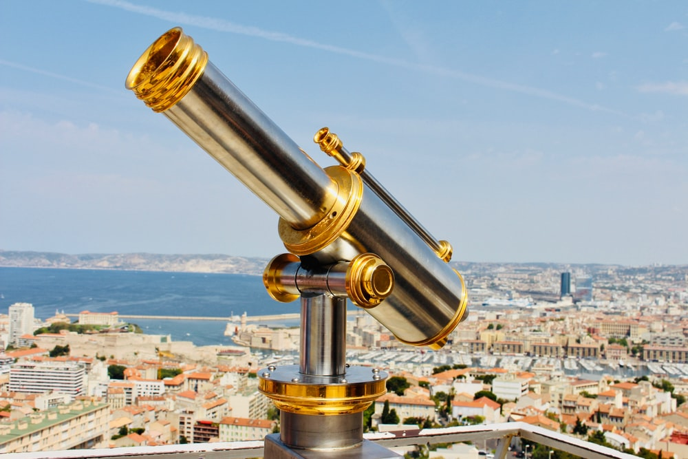 gray and gold-colored telescope at daytime