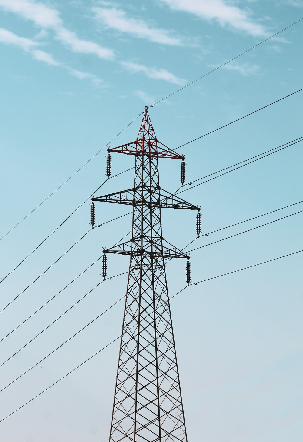 electric transmitter under blue sky
