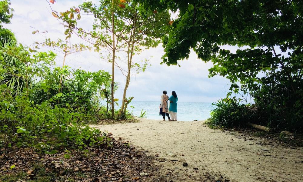 women standing near sea