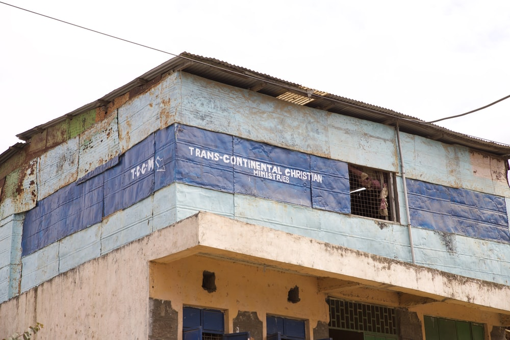 blue tarpaulin with Trans-Continental Christian text