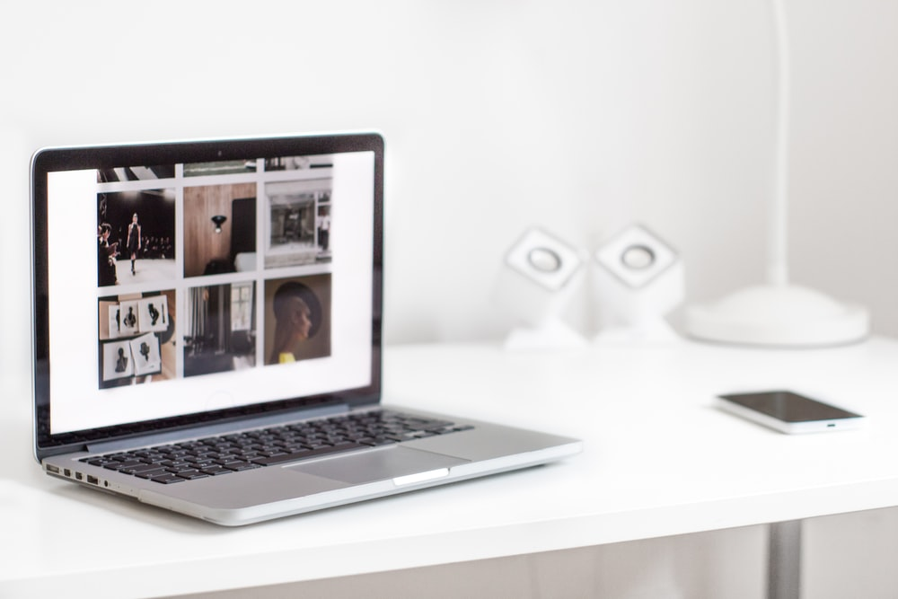 turned on MacBook Pro on table