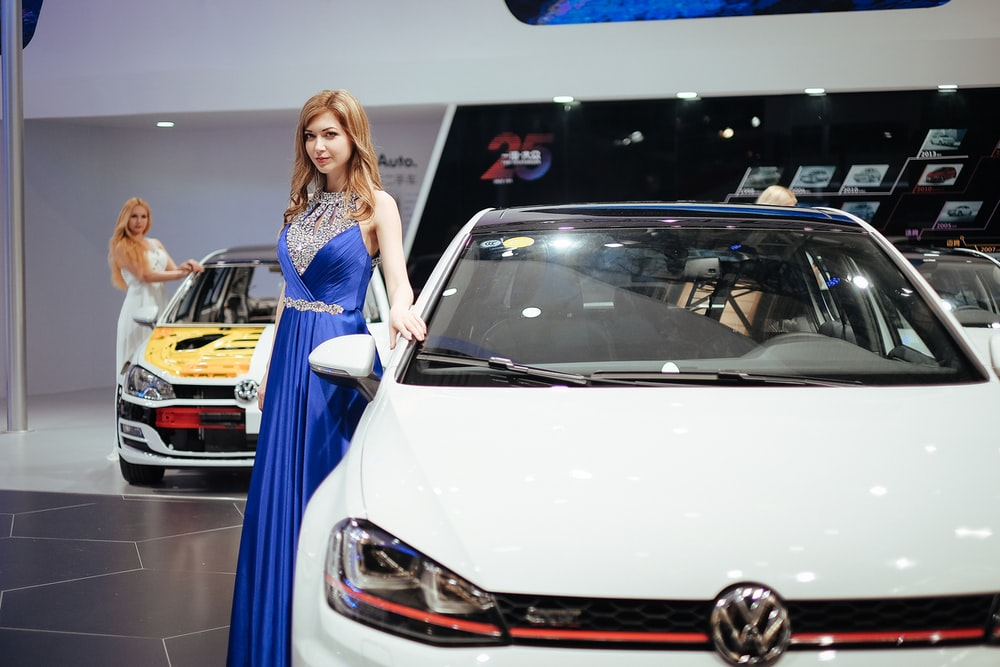 woman standing near Volkswagen car