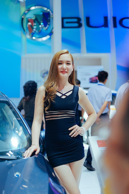 woman wears black tank dress