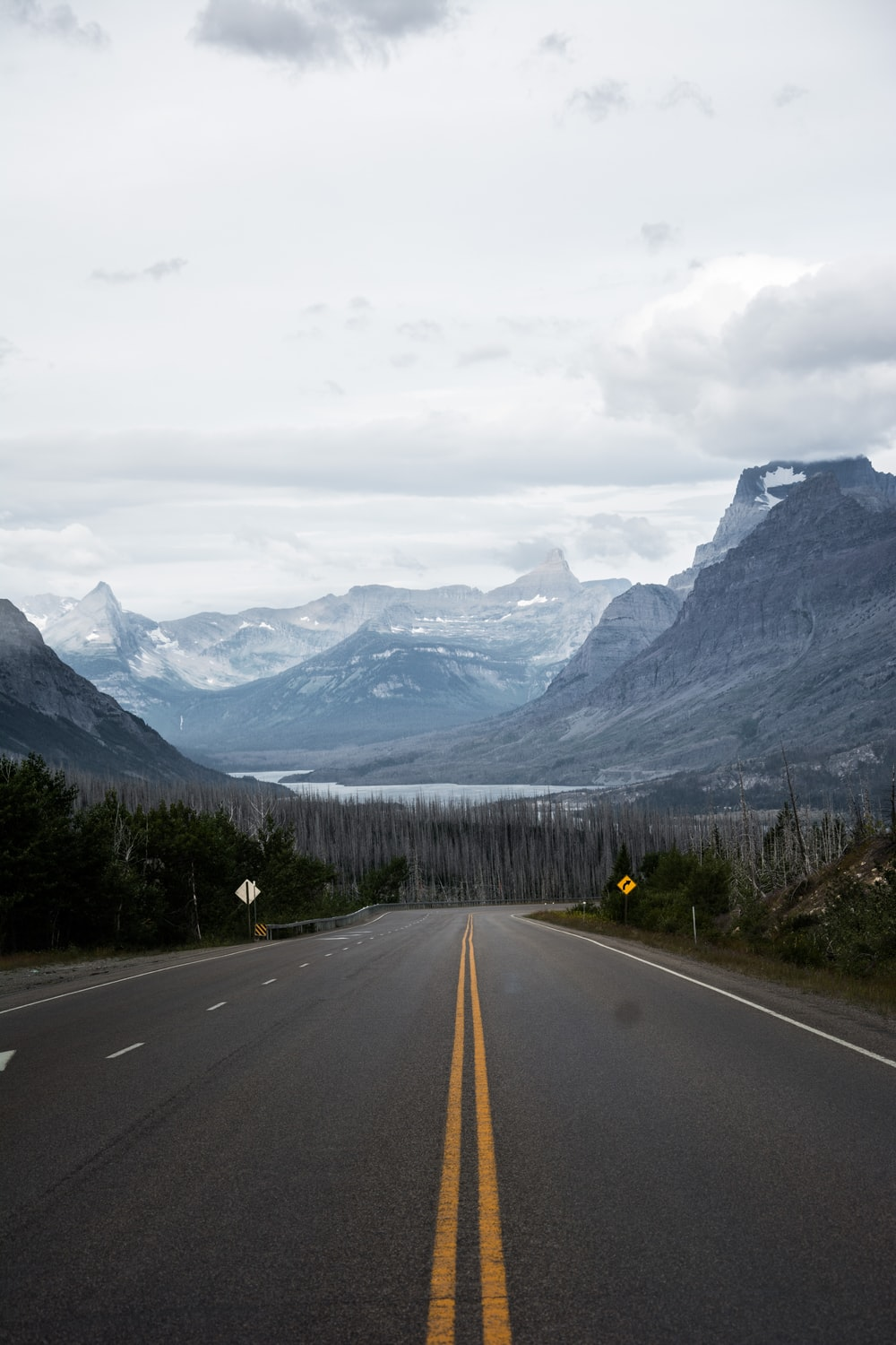 empty road front of mountains at daytime