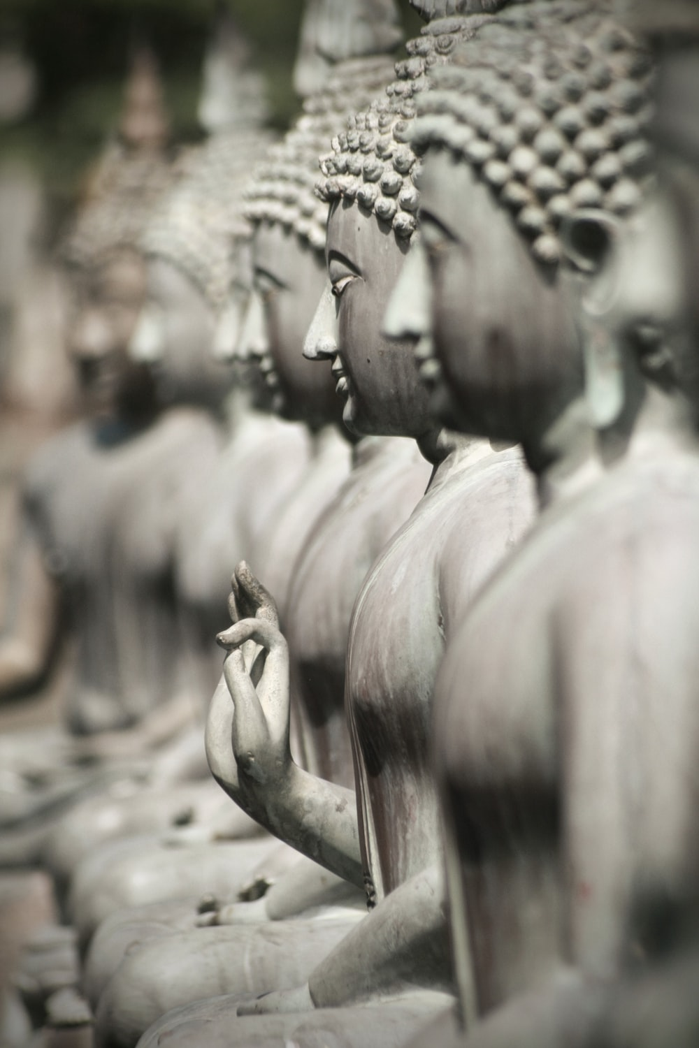 grayscale photography of Buddha statue