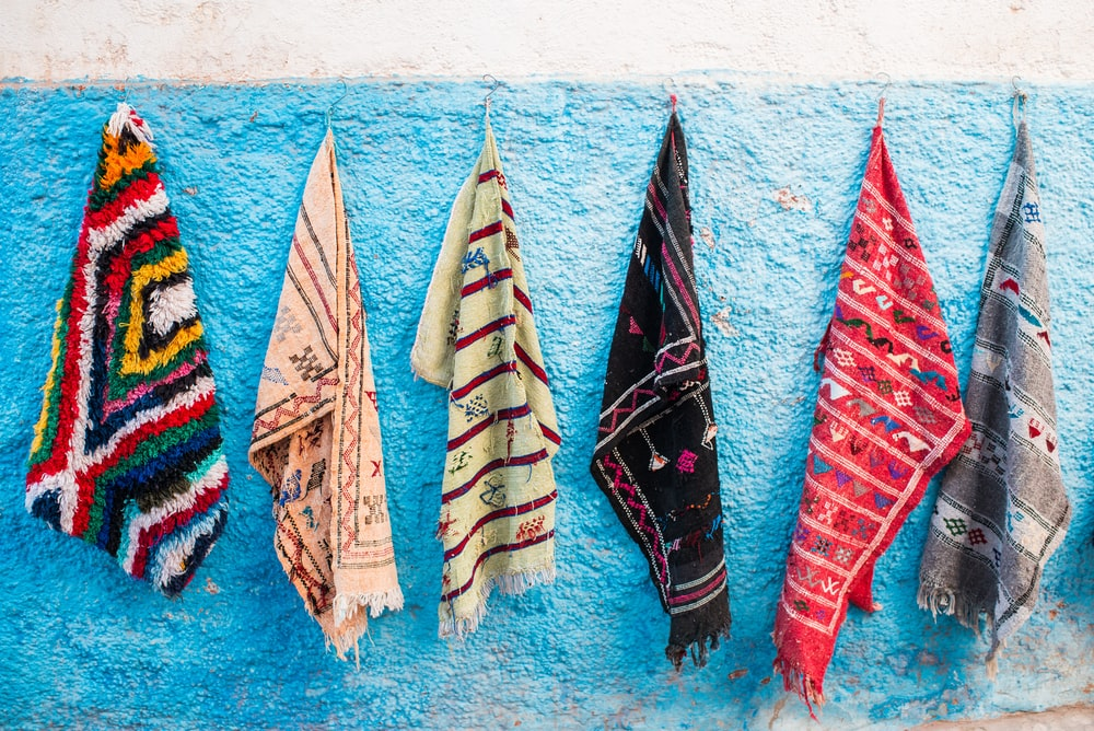 six hanged assorted color textiles