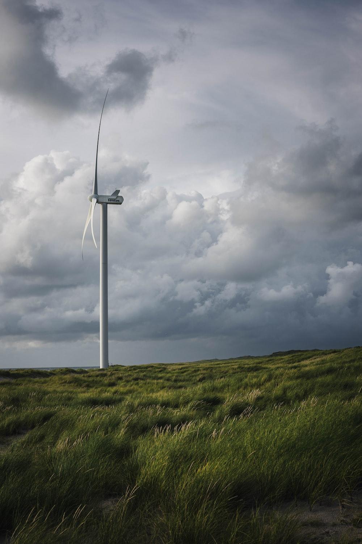 white windmill near grass