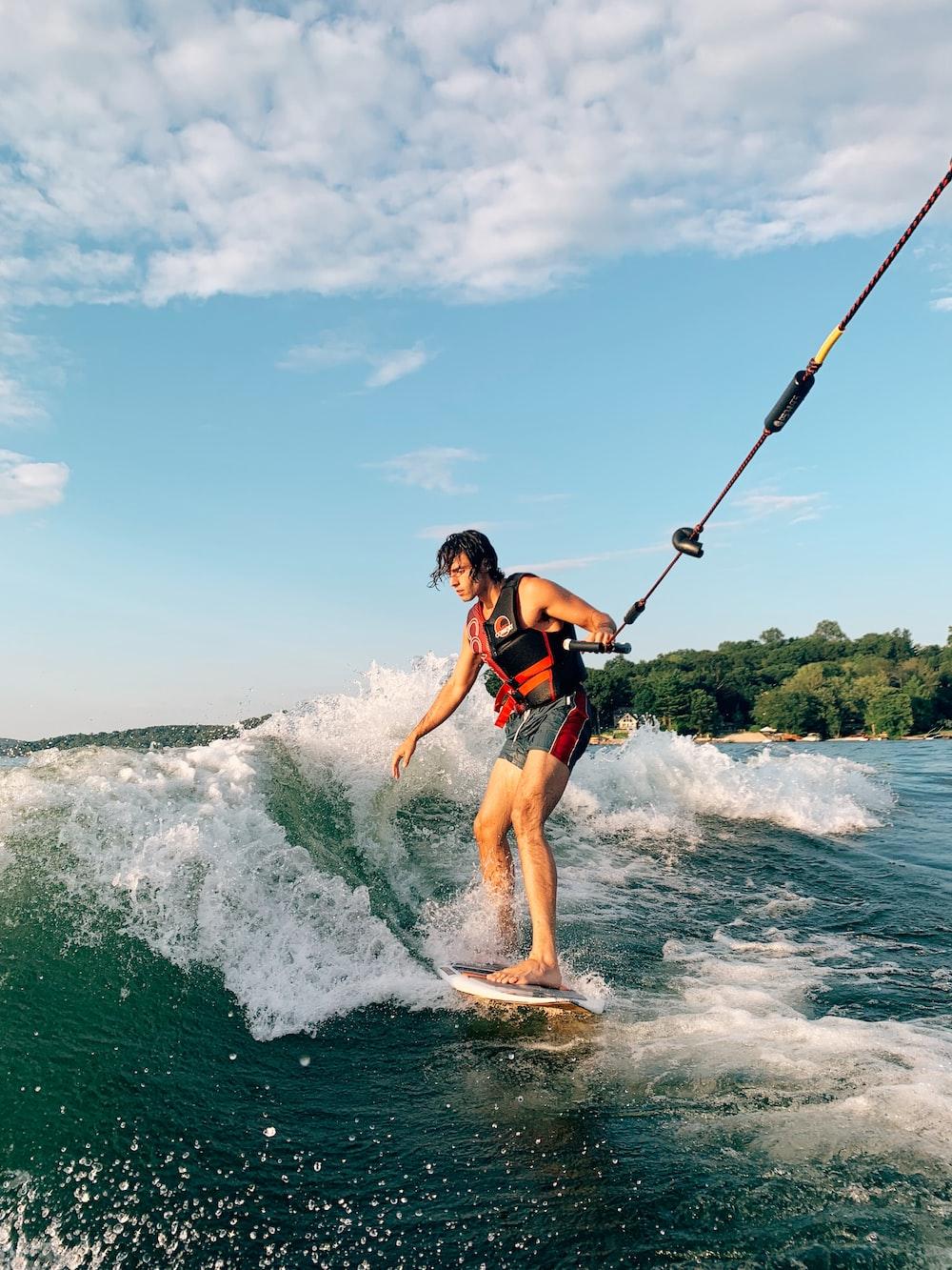 man wakeboarding on sea