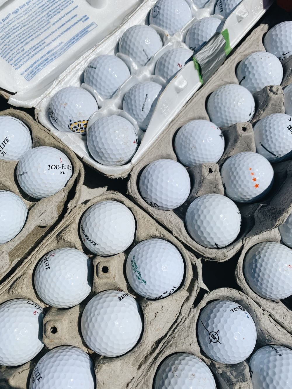 pile of golf ball in box