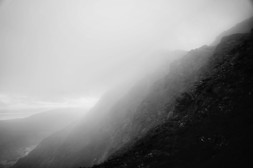 mountains and fog during day