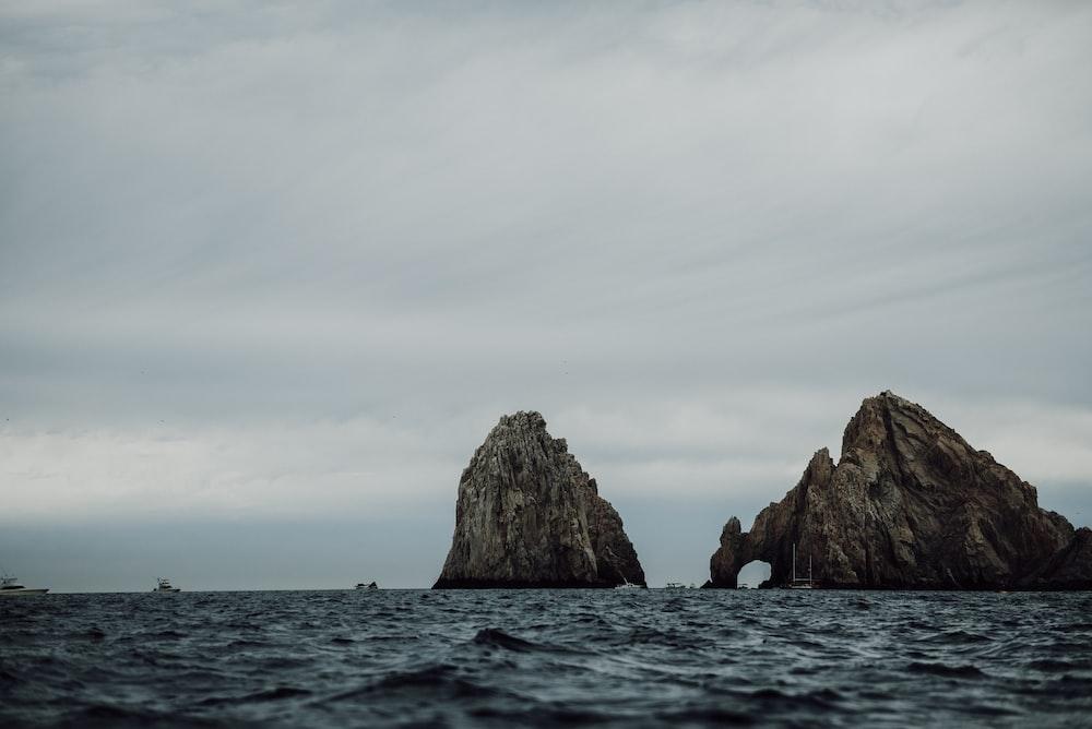 cliff beside ocean during daytime