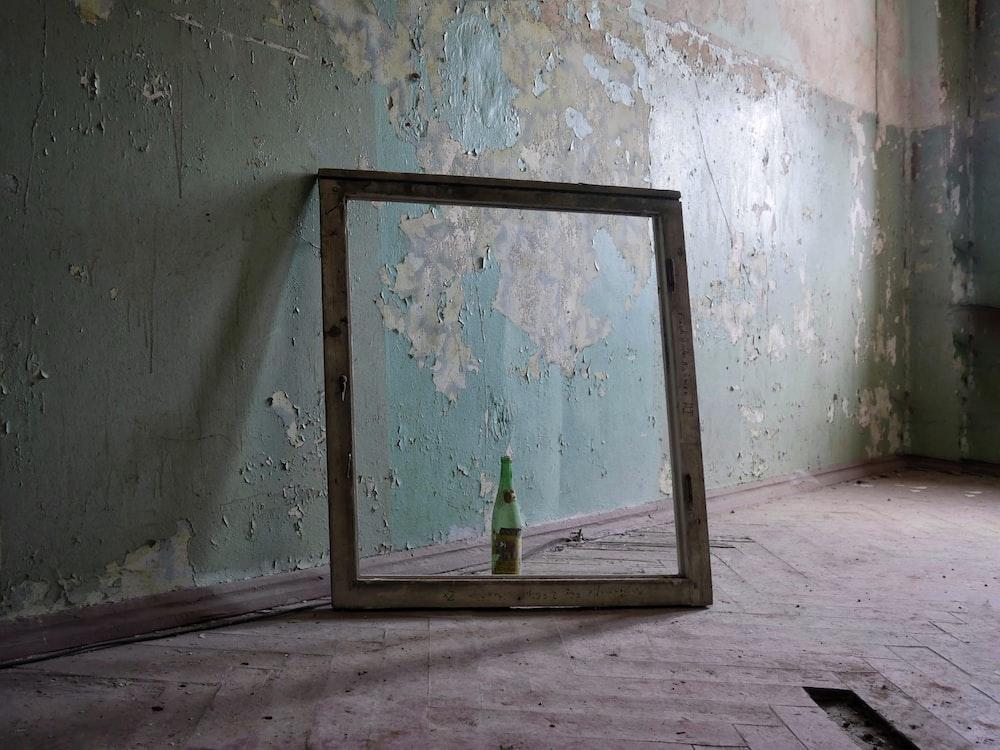 bottle inside wooden frame