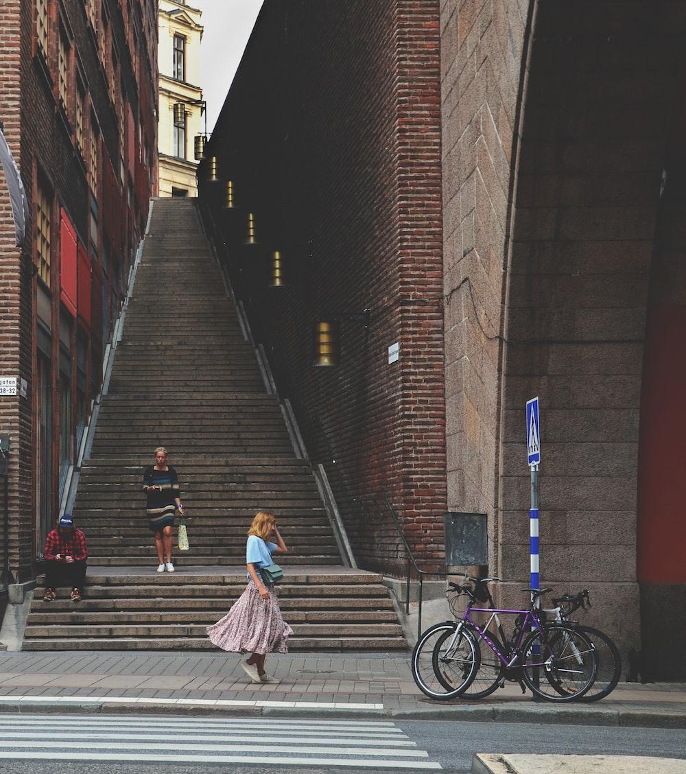 woman walking beside stairs