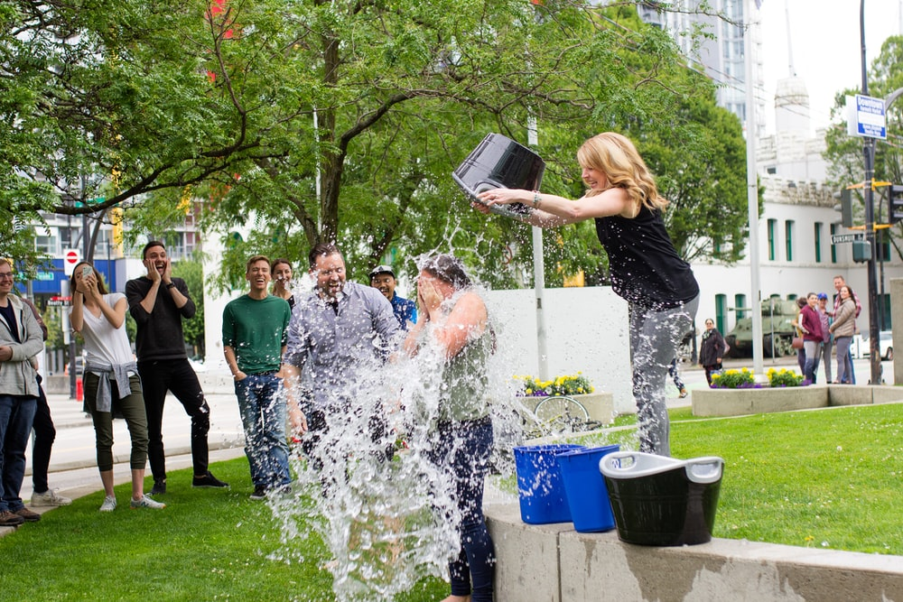 woman pouring water on another person