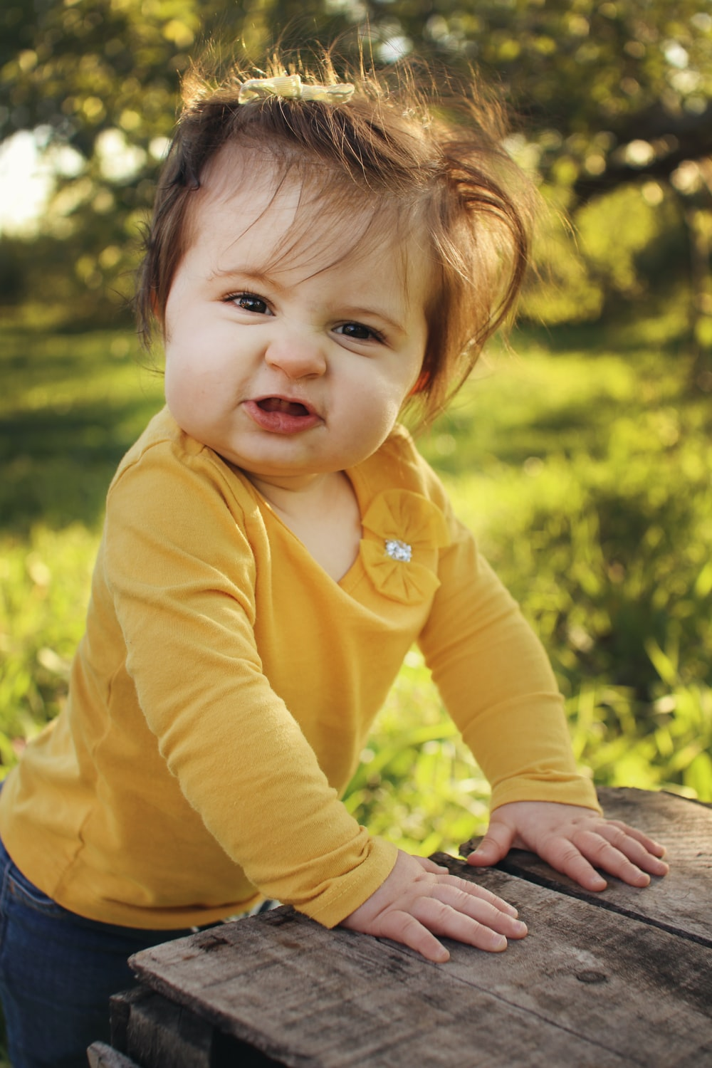toddler wearing yellow long-sleeved shirt