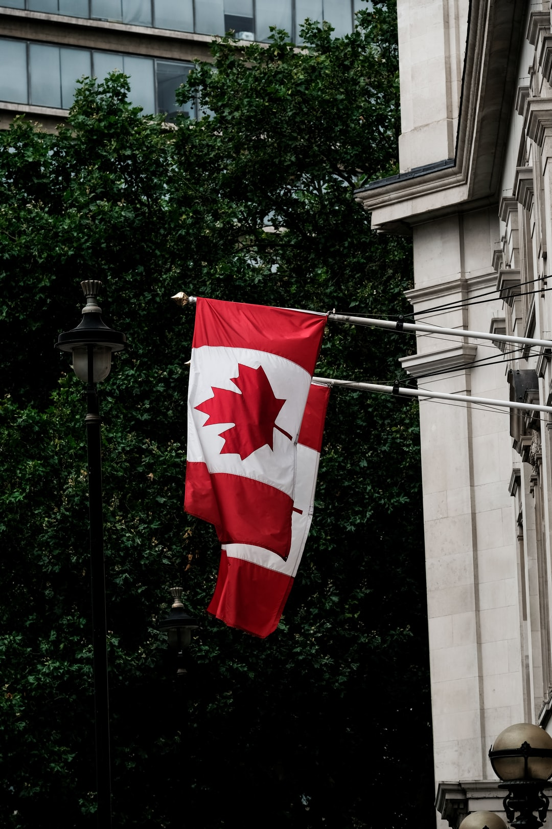 Canadian flags hanging on the outside of the Canada House in Central London.