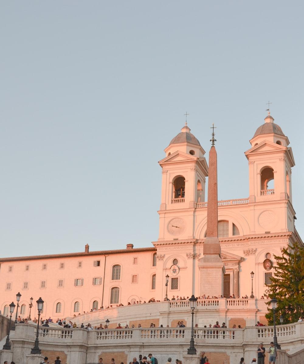 people walking beside cathedral