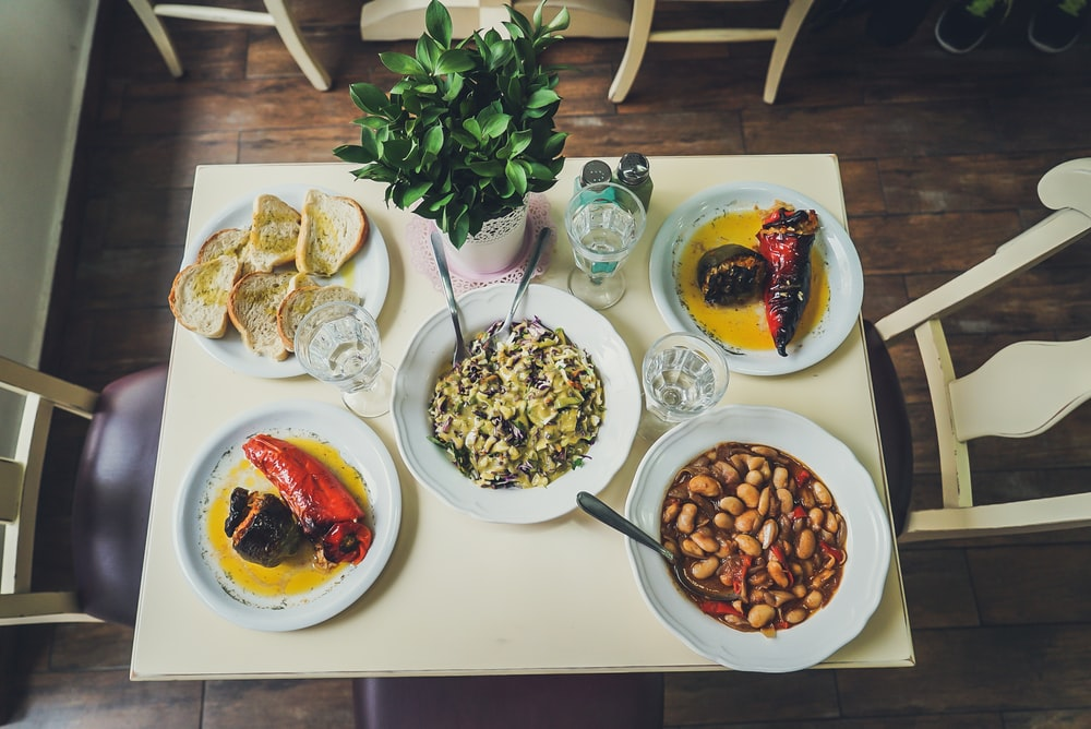 assorted foods on plates on table