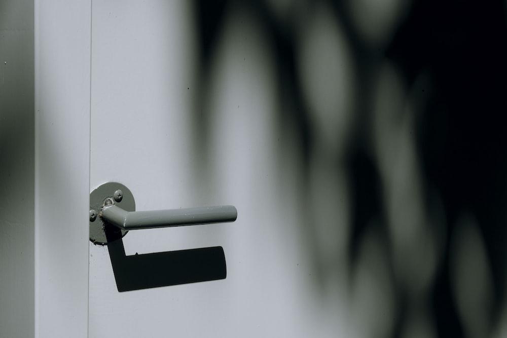 gray metal door lever