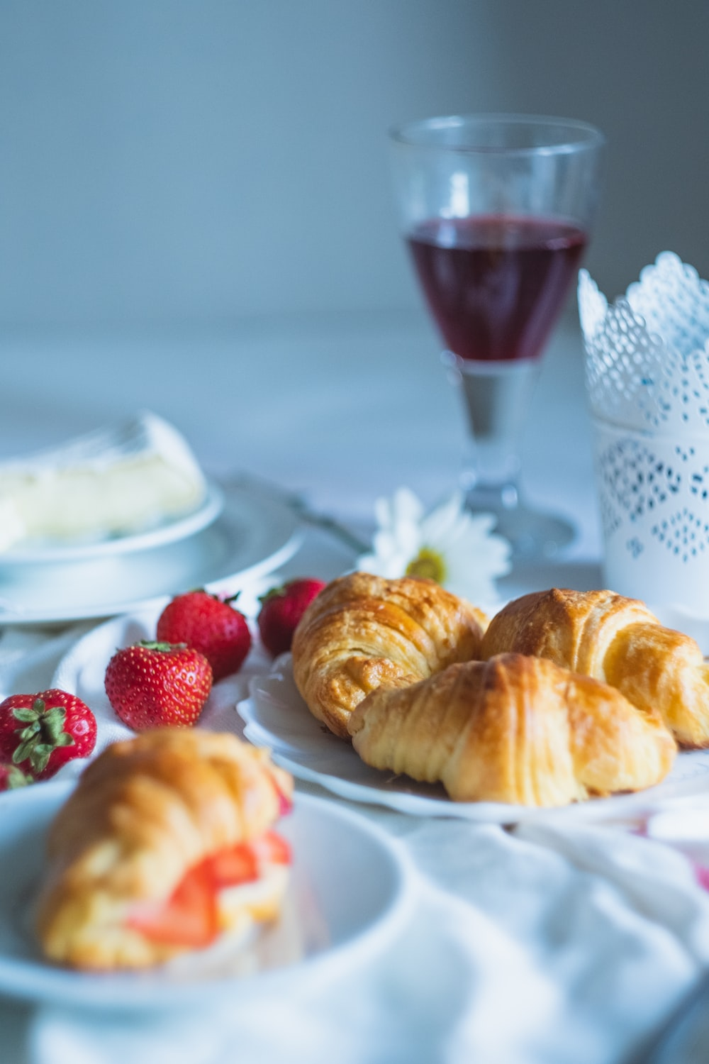 croissant in plate near strawberry fruits