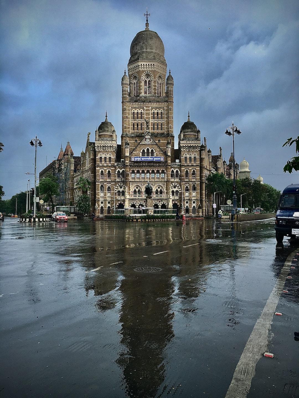 Portrait of a city.   [Municipal Corporation of Greater Mumbai (MCGM) Headquarters, opposite Chhatrapati Shivaji Maharaj Terminus, Mumbai, on a rainy August morning.]