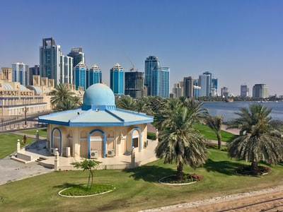 city with high-rise buildings viewing sea during daytime united arab emirates zoom background