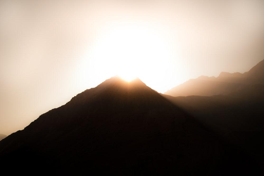 sun rays coming through mountain