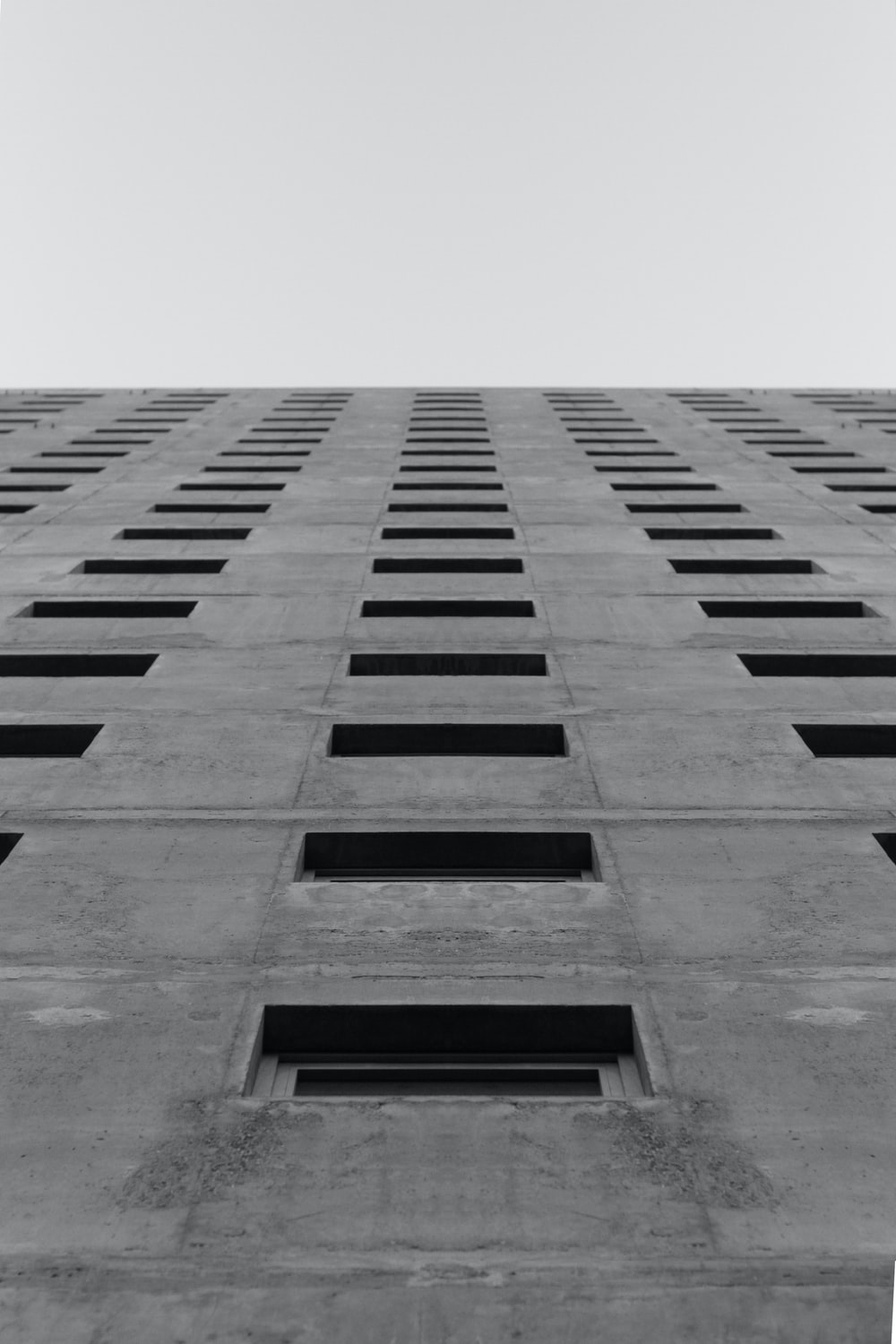 low-angle photography of concrete building at daytime