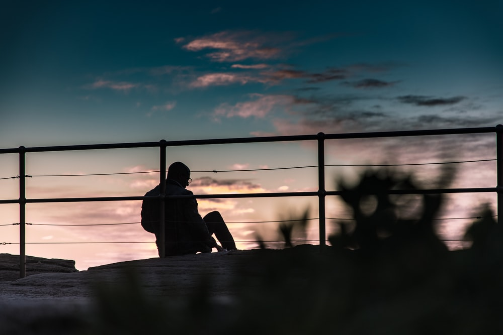 silhouette photography of person sitting