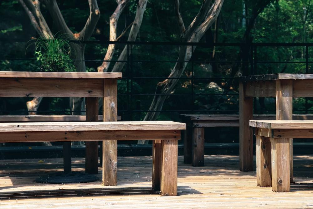 rectangular brown wooden garden tables during daytime