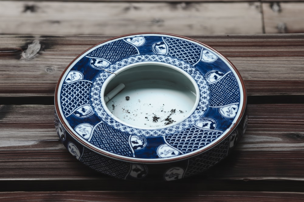 round blue and white ceramic ashtray