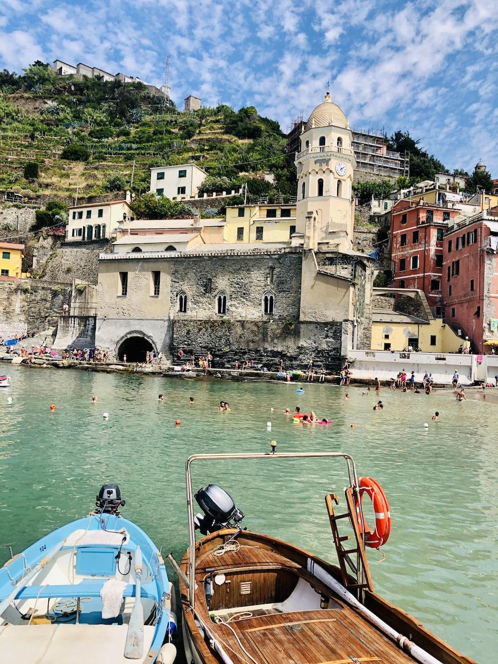 people swimming in sea beside church