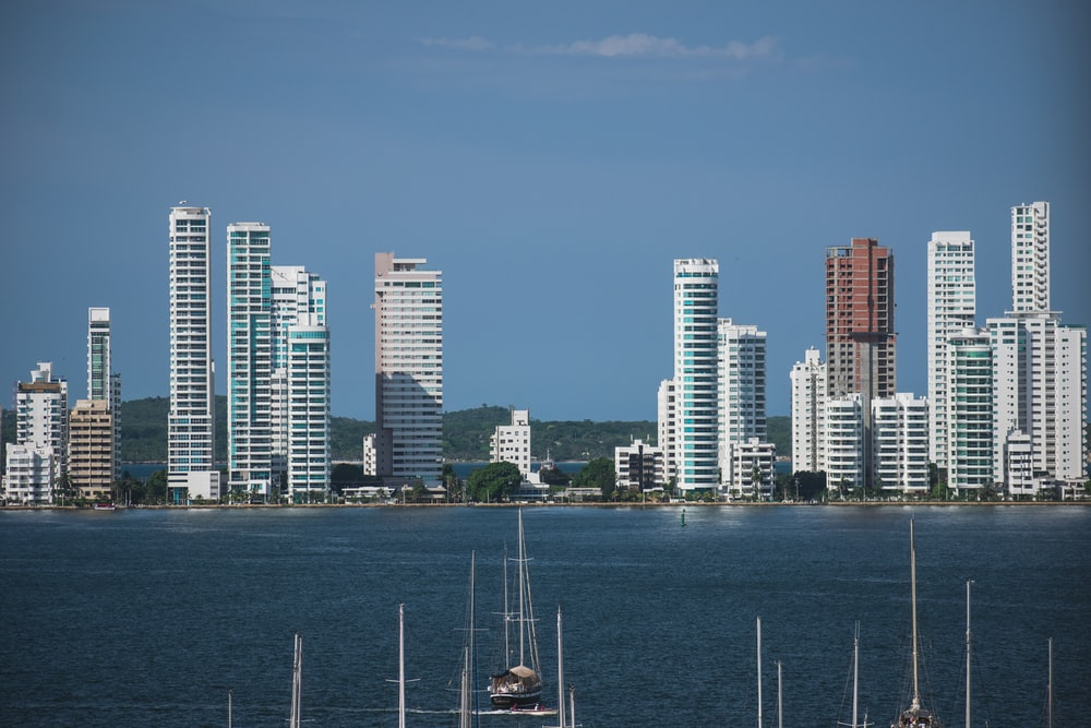 body of water and city buildings