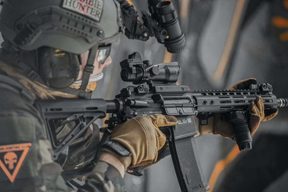 close-up photography of person holding rifle