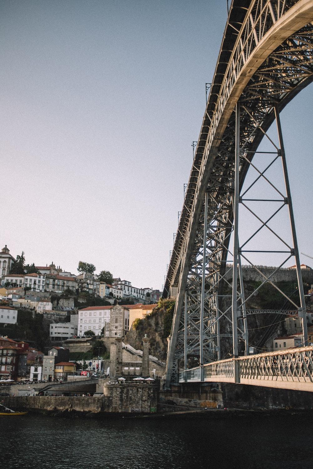 bridge near city during daytime