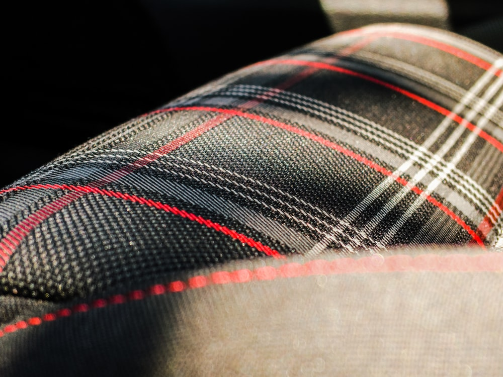 black, gray, and red plaid textile macro photography