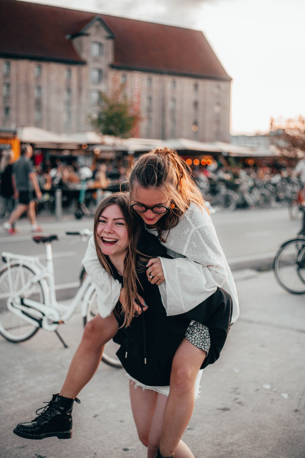 woman piggy back riding another woman
