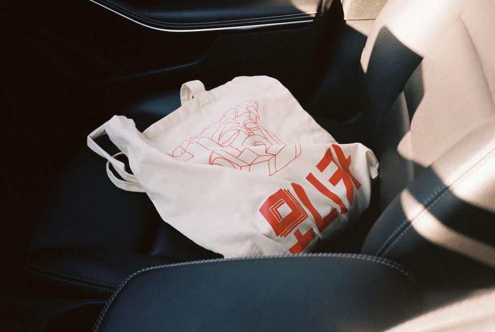 white and orange tote bag