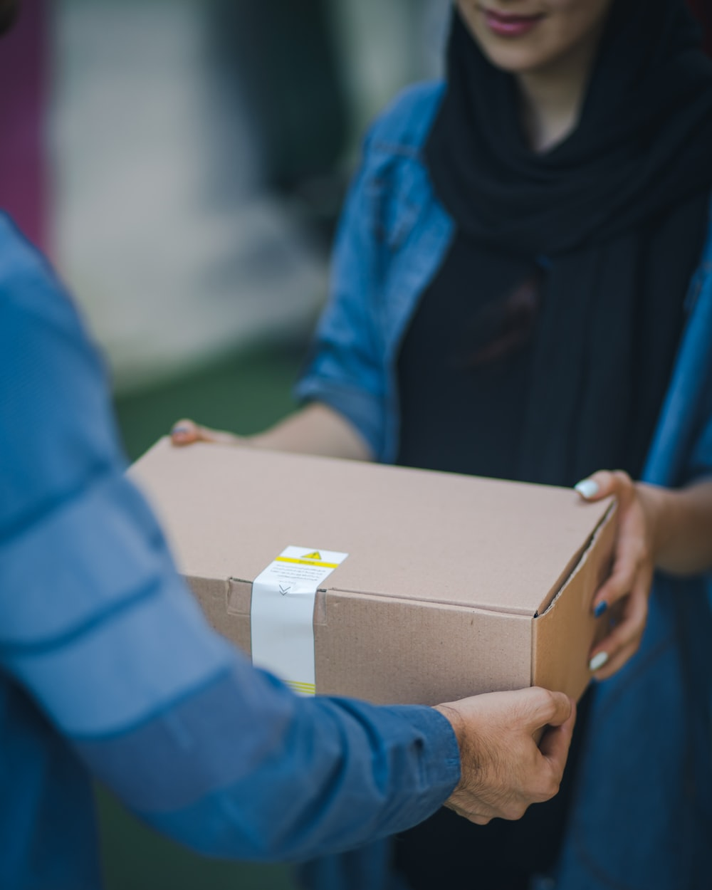 person giving brown box
