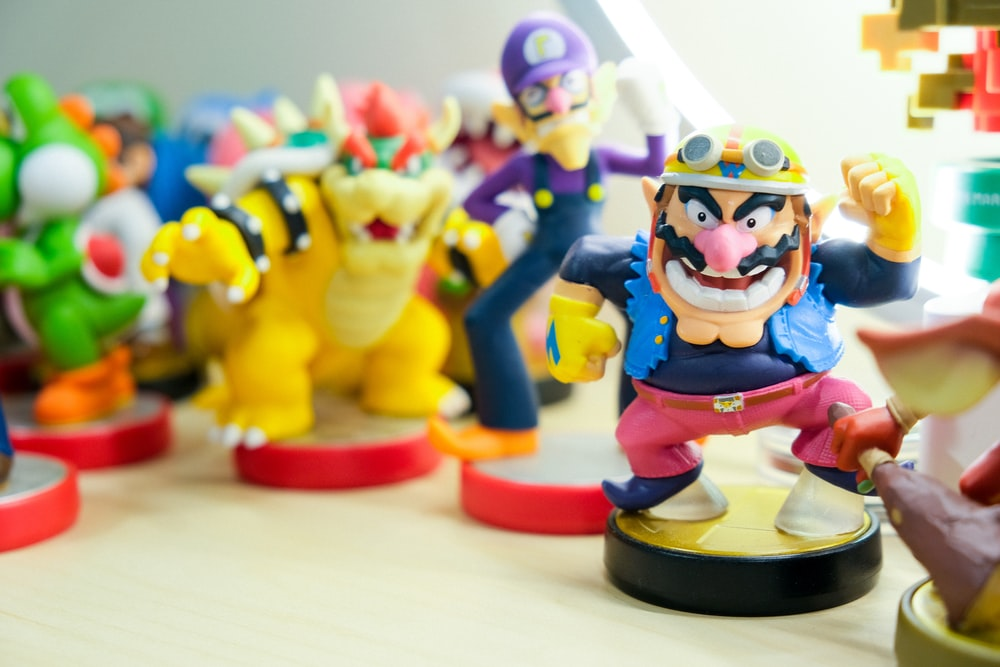 Super Mario vinyl figures on table