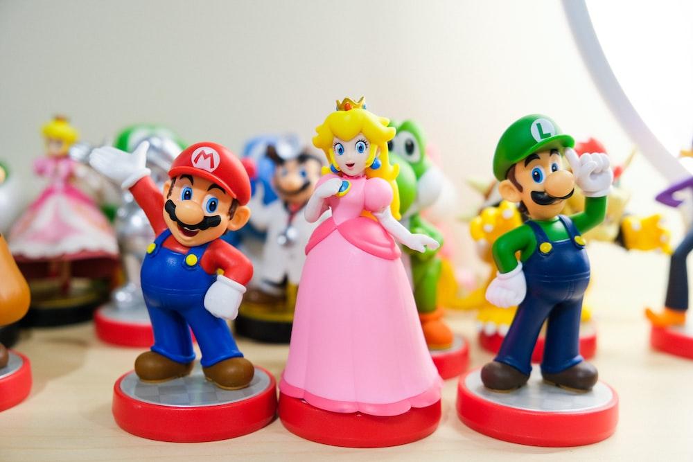 Mario, Luigi, and Princess Peach figurines