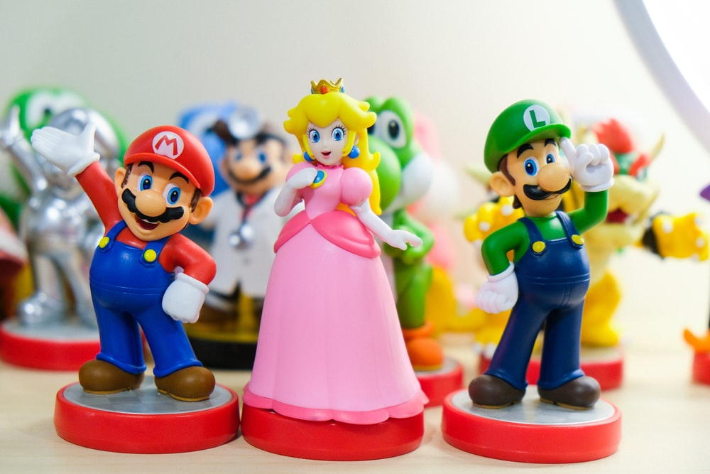 Super Mario, Luigi, and Princess Peach figurines