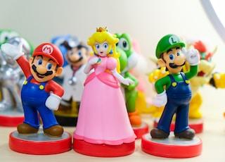 Super Mario, Luigi, and Princess Peach figurines