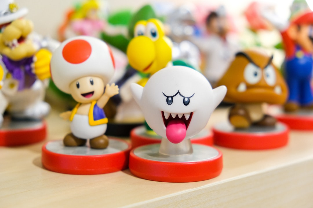 Nintendo amiibo toys of characters of Boo ghost, Toad, Goomba, and Koopa Troopa