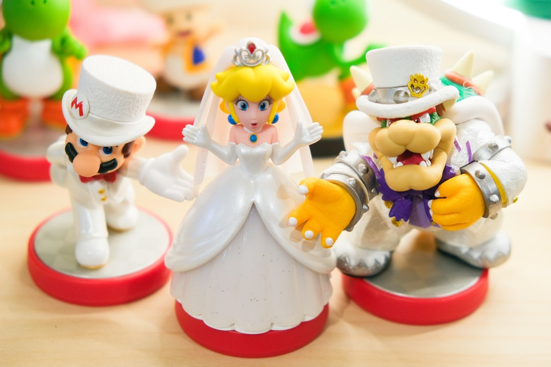 Nintendo amiibo toys of characters of Wedding Mario, Wedding Princess Peach, and Wedding Bowser proposing marriage focusing on Mario and Bowser